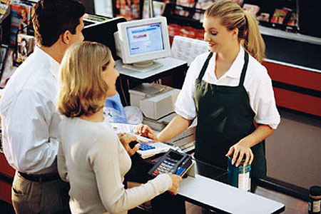 Grocery Cashier Serving Customers